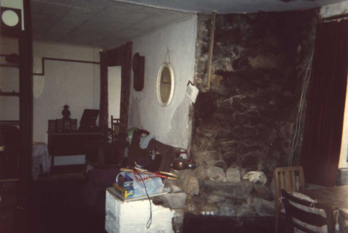 showing boarded up window to the left